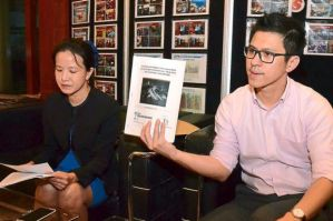 Upset: Wong (left) with SNTD member Alvin Chin who is holding up a copy of the 2012-approved EIA report on the proposed Dash highway route.