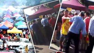 Dua lelaki dipercayai warga asing cuba mengalih kenderaan yang diletakkan di tapak Bazar Ramadan di Damansara Damai. (Gambar dari FMT)