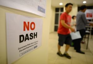 """A placard reading """"No DASH"""" is pictured during a press conference to object the RTPJ2 amendments, which the proposals have included the Damansara-Shah Alam Elevated Highway (DASH), in Damansara Perdana on September 1, 2014. The Malaysian Insider/Najjua Zulkefli"""